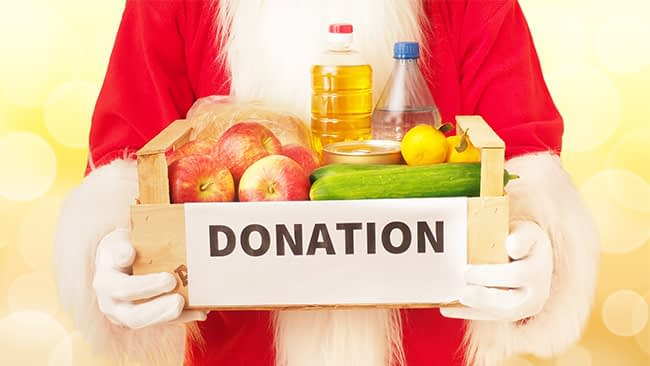santa holding Christmas charity dontaion box